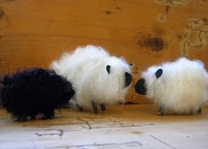 yarn cardboard twigs and black paper form these adorable little lambs.  We are putting tiny flowered wreaths around the necks to make them festive for Easter!