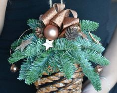 Christmas is a special time... Let the decorations create a magical Christmas spirit in your house...   This listing is for Large Pine Cone Christmas Ornament  This arrangement will look great wherever you hang it above the fireplace or stairs. Why not hang it on the door frames or in the windows! It can work as a unique gift for friends and family! I would be happy to send your gift directly to the recipient with a message included from you.  Materials used: pine cone, matching silver…
