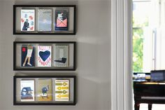 Hang favorite books in shadow boxes on the wall.