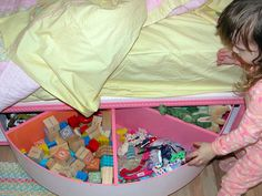 An under-bed lazy susan toy storage.