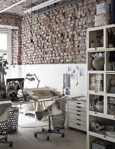 Amazing home office space with lofted ceilings and distressed brick walls