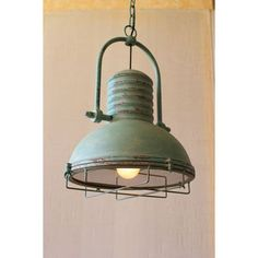 This lighting has the perfect combination of a married industrial and French cottage style. The antique turquoise paint feminizes the masculine metal and caging. This is a must have kitchen bar light or bathroom pendent!