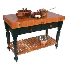 This striking butcher block table from John Boos has a 4-inch thick American Cherry end-grain top with shelf and a black base.  #kitchensource #pinterest #followerfind