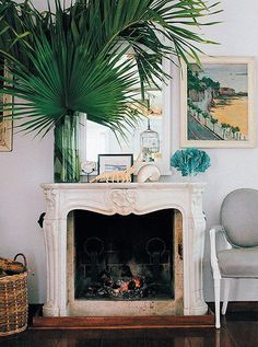 Treasures from the sea and palm fronds from a nearby coconut grove add some serious island style to India Hicks' fireplace.
