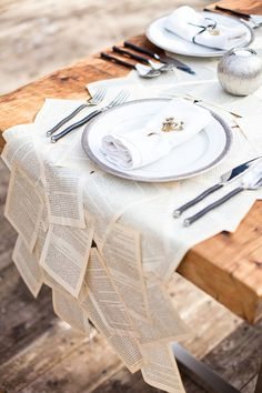 you might think this is totally gay but something like this from your favortie book?? Bring in the outdoorsy wood feel to the wedding? Creative wedding table runner