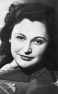 Nancy Wake, shown in 1945, was a spy and became one of the Allies' most decorated servicewomen for her role in the French resistance during World War II.