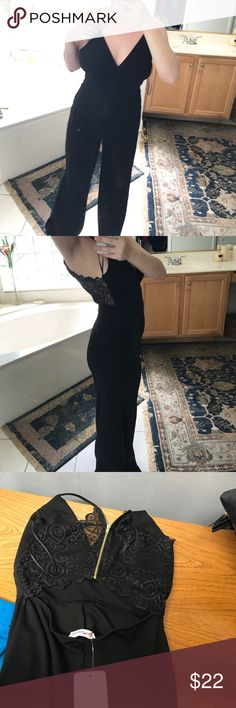 Black fitted Jumpsuit NWT Brand new stretchy black jumpsuit with lace back  super comfy and chic! Pants Jumpsuits & Rompers