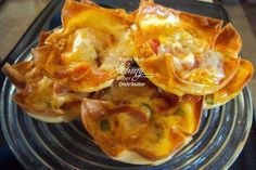 Breakfast Cups  Serves: 8 8 egg roll wrappers, cut in 1/4 1 c. Egg Beaters... 1/2 tsp. Nature's Seasoning 16 turkey pepperoni, cut in 1/4 1/2 c. shredded pepper jack cheese 1/2 bell pepper, diced fine Conventional Oven: Preheat oven 350° Coat muffin tin with cooking spray. Place one square of egg roll wrapper in tin well and slightly push down in the center. Leave the corners sticking up. Mix egg with seasonings. Scoop 1 Tbsp. seasoned egg into each well. Add veggies and meats. Top with ...