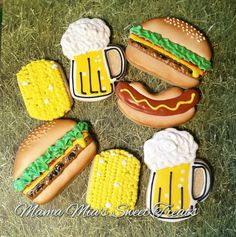 Hamburger,  hotdogs,  corn on the cob and beer!  Perfect sugar cookies for a picnic.