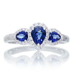 Omg.  Omg.  Anyone who knows me knows sapphires are my second favorite stone behind opals and before diamonds.  This ring is freaking gorgeous! It's a bit untraditional, but basically the perfect ring.  Maybe replace the middle sapphire with a diamond? Maybe not tho...