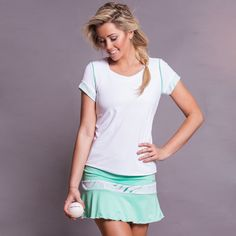 Calypso green tennis skort with white lace insert detail above hemline. Made in USA. SHOP Activewear http://www.denisecronwall.com/#!product/prd13/2521065541/calypso-skort-(green)