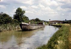 BW197-2-26-41 a British Waterways motorboat leaving a narrow lock