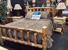 From Great Northern Logworks.  Queen size log bed, 1-drawer log nightstands.