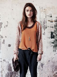 Outfit by Maison Scotch. I love the sweater and the orange blouse.