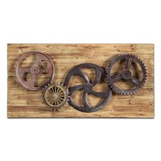 Rustic Power. Smooth, rusted wheels contrast with rough, jagged ones in the Industrial Gears wall décor. Four gears seem to roll right off the rough-hewn wood background in this juxtapositional piece.