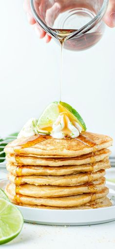 Fluffy graham cracker flecked pancakes with a kiss of lime and a whole lot of YUM! These tropical key lime pie pancakes are positively DELICIOUS and so easy to make!