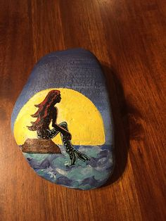 Beautifully designed little mermaid on a soft tumbled rock. Approximately 5x3 inches.