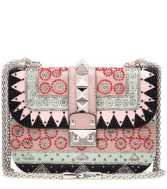 Valentino - Ballet Russes Lock Small embellished leather shoulder bag - Add more glamour to your daily and evening ensembles alike with Valentino's Ballet Russes Lock Small shoulder bag. Crafted in Italy from smooth printed leather in a pastel palette, this piece is coated with shimmering beaded embellishments and the designer's signature Rockstuds. The sweet, powerful piece instantly locks in a glamorous look. seen @ www.mytheresa.com