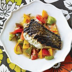 Chef Floyd Cardoz, an avid fisherman, will focus on seafood dishes at his upcoming downtown-Manhattan restaurant, North End Grill. A favorite is this summery grilled bass with ginger-spiced tomato salad.