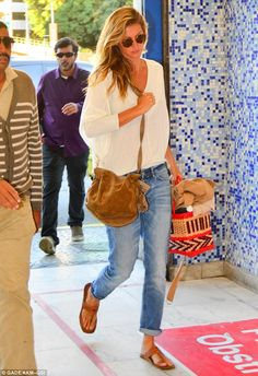 Laid-back: Gisele Bundchen dressed comfortably on Saturday as she prepared to fly out of Brazil after appearing in the opening ceremony for the Olympics