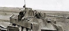A Panther Ausf D nr. 314 with it's crew, while operating on the Eastern Front, is part of a larger group of Panthers