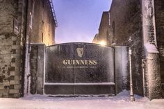 The iconic gate at Guinness used in the famous Christmas ad. It snowed heavily in Dublin and I had to walk through the snow and back to get the shot. Note the Guinness sign on the gate. The photo is like a Guinness poster. Dublin at night. Christmas Ad, First Photograph, Guinness, Dublin, Gate, Beer, Snow, Night, Photos