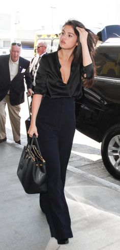 Selena Gomez's looked fresh and fabulous in an all-black outfit headed to the airport.
