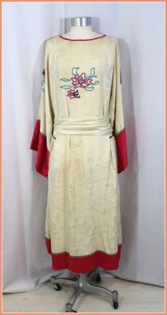 Early 1920s ivory silk jacquard day dress with raspberry shantung trim and embroidered flowers.