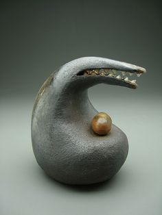 Dark Bird with Egg by Eva Funderburgh, via Flickr