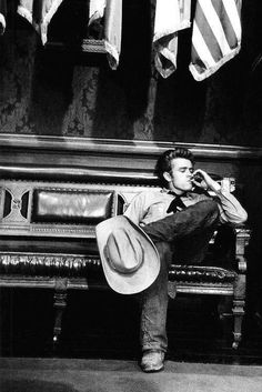 "James Dean on ""Giant"" 's set, 1955 #cowboy #fashion At Eagle Ages we loves cowboy boots. You can find a great choice of second hands & vintage cowboy boots in our store. https://eagleages.com/shoes/boots/men-boots/cowboy-boots.html"
