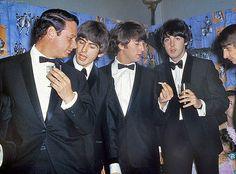 George Harrison, John Lennon, Paul McCartney, and Richard Starkey (with manager Brian Epstein)