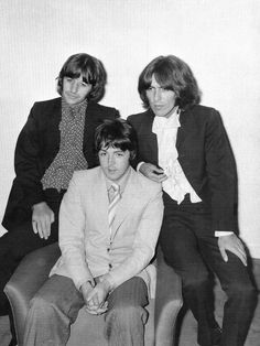 Ringo Starr, Paul McCartney and George Harrsion with a cardboard cutout of John Lennon in London, July 8th 1968.
