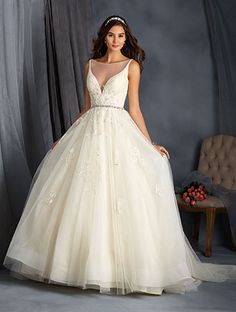 Alfred Angelo Style 2565: ball gown wedding dress with plunging neckline and crystal bead and rhinestone trim