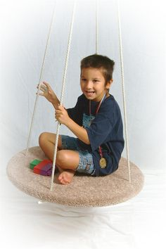 The Circular Platform Swing - Useful in the development of a child's vestibular system by forcing them to accept more movement sensations. Different movement sensations and repetitive swinging motion has been known to help calm an regulate and over stimulated child.