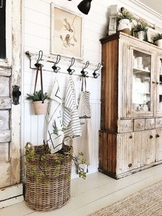 Farmhouse Dining Room - lots of great design ideas for getting that rustic farmhouse look, including painted furniture and hardwood floors, shiplap walls, industrial lighting, mismatched furniture and collected ironstone - via Liz Marie Blog