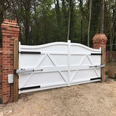 """Finished in white, our """"Berkshire"""" driveway gate with above ground automation. Fully installed, produced and painted by Gates and Fences UK. Electric Driveway Gates, Electric Gates, Gate Hinges, Sliding Gate, Brick Wall Gardens, Gate Company, Old Gates, Gate Automation, Gate Operators"""