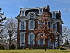Old house. Beautiful brick Second Empire located on Columbus St. in Wilmington, Ohio. Off of highway 22. Note the traditional corner entrance as well as the secondary door on the left. Beautifully restored and manicured.