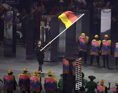 Timo Boll carries the flag of Germany Rio 2016