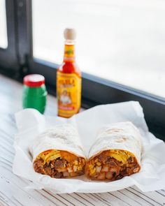 Buenos días San Diego!  With 5 breakfast burritos to choose from this is more than your average taco stand.  Pictured is our customer favorite Carne Asada  Egg Burrito. This burrito is a hearty breakfast wrapped in a warm flour tortilla includes 100% Angus Beef egg cheese beans and fresh salsa.  #thetacostand #LaJolla #hechoamano #breakfastburrito