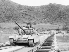 A Centurion tank of the 8th King's Royal Irish Hussars passes over a pontoon bridge over the Imjin River. 1950