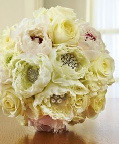 """Ornate white peony bridal bouquet with jewels as featured on the 1800Flowers' flower blog, Petal Talk post, """"It's a Nice Day for a White Wedding' with White Wedding Flowers."""""""