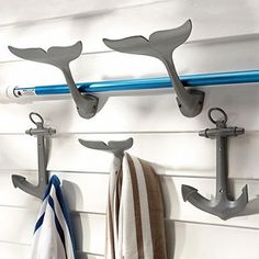 Adding some sailing-inspired hardware/rope to a home | Ocean Interiors Design  I'm in love with these hooks. Especially the whale tails.