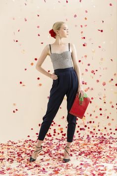 Alice + Olivia resort 2014, modified haram pant with striped bustier and strawberry clutch.