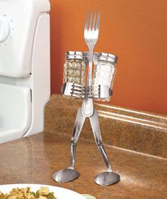 A Forked Up Art Salt & Pepper Stand is a functional piece of art for your table or kitchen counter. Metal silverware is bent and curved to create a ch Serveware, Tableware, Ltd Commodities, Forks And Spoons, Lakeside Collection, Home Renovation, Salt And Pepper, Fun Crafts, Art Pieces