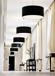 huge black drum pendant lampshades and lavish ivory and black draped curtains - ByMaleneBirger_HQ