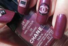 "Chanel Le Vernis ""Fuchsine 29"" nail polish (direct sunlight) + chanel coco perfume/bag/logo decals."