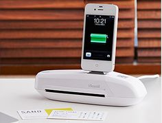 A cradle for the iPhone, iPad, and iPod, thats a mini scanner as well and can charge your devices.
