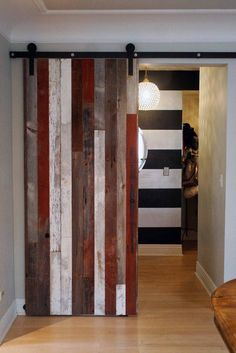 Love this reclaimed wood sliding barn door! So cool.