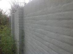 Het Cementen van een tuinmuur