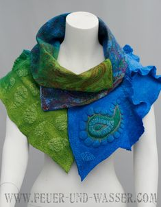 A vibrant and luxurious big scarf, the Babushka Shawl Two reflects rich colors of a coming spring, with azure blue, teal, vibrant green and multicolored paisley print silk chiffon, handmade Uzbek silk, with 3-D paisley texture and silk embroidery. Hand-dyed. Fastening with a